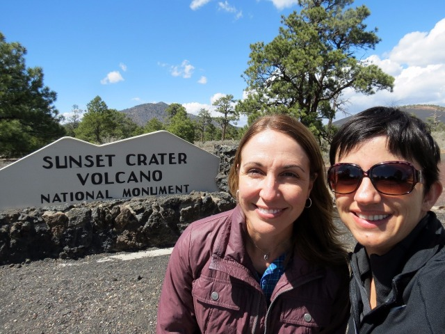 Selfie at the sign in the shape of the crater